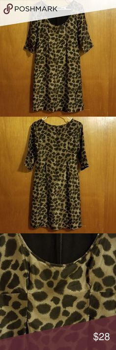 Rebecca Taylor 3/4 Sleeve Silk Animal Print Dress Pretty Rebecca Taylor silk animal print dress with 3/4 sleeves, and low scoop neck.  100% silk crepe de chine.  Perfect for parties, dates, or throw on a blazer for work.  Gently used condition; the front darts are stretching slightly and there are a couple of very hard to see rub of fabric at back. Darts are shaped at bustline to create an empire waist effect, combined with the low scoop neck it is very sexy.  Invisible zipper in back…