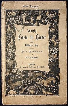 Antique German book. Typeface and animal border.