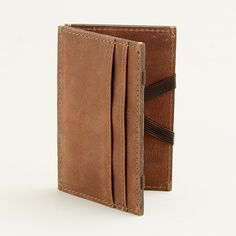 I really like this wallet and often get comments/questions about mine (which is slightly different), but alas, the elastic eventually over-stretches// j.crew Leather magic wallet, $24.50