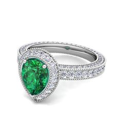 Pear Shaped Emerald and Diamond Engagement Ring in 14k Gold.