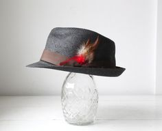 Reminds me of a hat my Grandpa used to wear, wonder where that is now?    vintage gray straw fedora. 1960s pork pie style. Feather grosgrain band, stingy brim.  Rockabilly Mad Men  / the BOARDWALK TAFFY hat. $28.00, via Etsy.