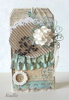 gorgeously detailed tag using memory box dies / like the pleated punched paper border