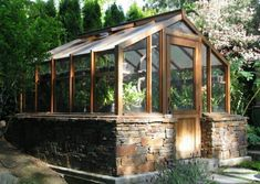 Someday I'll have me a wonderful little greenhouse like this!!  So cute!!