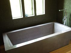 This concrete bathtub at the home we stayed in Oakland required ten men to lift, carry, and settle into place. It was molded from a single piece of concrete. Concrete Bathtub, Diy Bathtub, Poured Concrete, Stained Concrete, Cement, Loft Bathroom, Bathroom Plans, Bathroom Ideas, Shared Bathroom