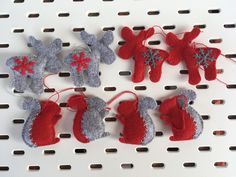 Felt ornaments are made of red and grey combination with hand made stitched detail and snowflakes. They are filled with polyester. Felt Ornaments, Christmas Ornaments, Christmas Settings, Red And Grey, Gift Bags, Christmas Time, Snowflakes, Create Yourself, Dinosaur Stuffed Animal