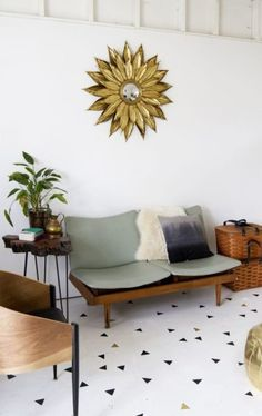 Beautiful sun mirror and midcentury modern furniture with contemporary floor