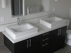 Blizzard Caesarstone with black/brown cabinets