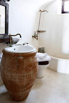 Mansion 1878, Santorini | Luxury Retreats I LOVE the idea of the urn as the sink!! Amazing