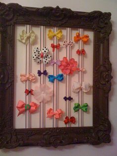 Bow holder for pink & brown nursery.