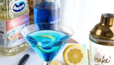 Blue Lagoon Cocktail - Easy Blue Drink Recipe! - Mom Foodie Vodka Cocktails, Easy Cocktails, Alcoholic Drinks, Cosmopolitan Cocktail Recipes, Elderflower Martini, Blue Lagoon Cocktail, Blue Drinks, Recipe Mom