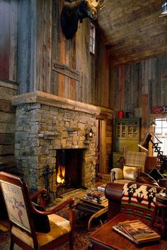 Future lodge home. Fireplace and rustic barn wood walls