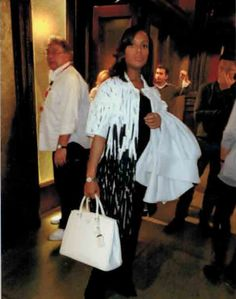 "Coat: ""Escada"" 'Cathy' White/Black Applique Pattern, Spap Front. Purse: ""Prada"" White Hard Body, 2 Handle Tote. Watch: ""Movado"" Silver w/ Diamonds"