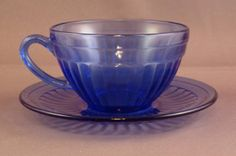 Aurora Cobalt Cup & Saucer Set - Cobalt Blue  Hazel Atlas Glass Co., ca. late 1930s  The Aurora pattern was issued only as a breakfast set, so the number of pieces in the collection are limited.