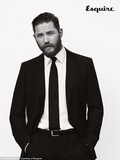 Suiting up: Tom Hardy looks suave in a moody photo shoot with Esquire Magazine...