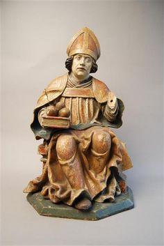 A Saxon wooden figure of St Nicholas of Myrna, c.1500, with symbolic attributes, a bishop's mitre and three balls/moneybags. (Staatliche Kunstsammlungen Dresden)