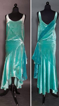 Evening gown, circa 1928-1932. Aqua silk velvet. Bias-cut skirt with uneven hem lengths. Left hip sash, attached silk charmeuse slip. Via Augusta Auctions.