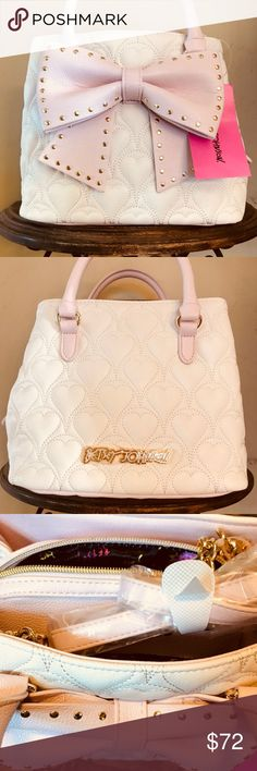 "Betsy Johnson Bow Bucket bag/cream Beautiful Betsey Johnson Bow Bucket bag. Features include- Dual rolled top handles with detachable chain accent shoulder strap  Center zip top closure with dual side magnetic top compartments  Exterior features allover quilted hearts and front bow detail Interior features three compartments, wall pockets and two media pockets H 8"" W 9.25"" D 5"" 5"" Handle drop, 8 "" strap drop Betsey Johnson Bags Shoulder Bags"