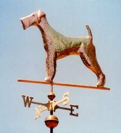 Airedale Terrier Dog Weathervane by West Coast Weather Vanes.  Customers can provide photographs of their special canine pets for a customized  weather vane depicting  their favorite dog.