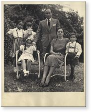"Dr Charles Drew pioneered methods of storing blood plasma for transfusion and organized the first large-scale blood bank in the U.S. nicknamed ""Blood for Britain"" during WWII. [Pictured: Charles Drew and his wife Lenore, outdoors with their children]. [ca. 1949-1950]."