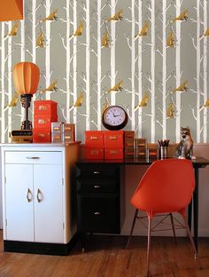 This is a really well decorated room considering the crazy wallpaper
