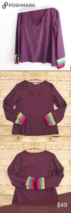 Purple and rainbow long sleeve Bowden blouse, 6 Beautiful great condition Boden grape purple top in a size 6. Rainbow colored sleeves. Maroon/red/blue/yellow. Stretchy material on the ends of the sleeves. Slight v-neck. A little wrinkly, it just needs to be steamed out. 50% silk and 50% viscose. Total length- approximately 22.5 inches, bust- approximately 17 1/4 inches, sleeve length- approximately 22 3/4 inches. Boden Tops Tees - Long Sleeve
