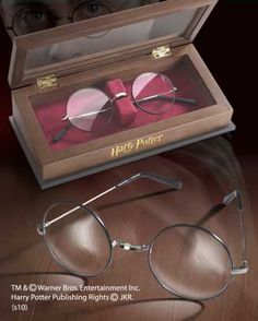 Harry Potter's Glasses   Quality replica of HARRY POTTER's glasses with wood display case. Total width is 4 3/4 inches. Each lens is 1.75 in diameter.