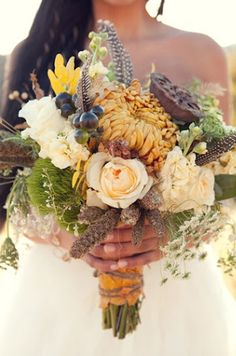 country style bouquet: I like how everything is different but blends together.
