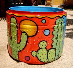 Believe it or not...this cool looking outdoor planter is a recycled washing machine drum