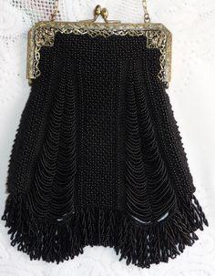 Black on black beaded knit purse on antique filigree purse frame.