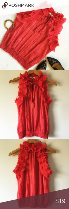 """{Ya Los Angeles} High Neck Sleeveless Blouse Beautiful sleeveless blouse with bold ruffles around neck and shoulders. Key hole opening that ties at neck. Stretch smocking detail at bottom hem. Color: coral. 20"""" pit to pit. 23"""" shoulder to bottom of hem. 55% cotton 45% polyester. Good preloved condition. Ya Los Angeles Tops Blouses"""