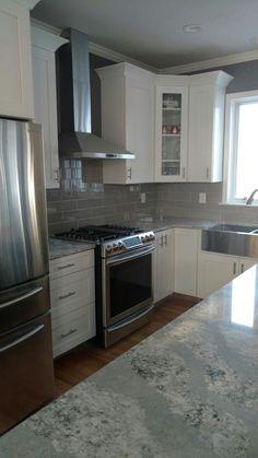 Summerhill Quartz. 4x16 subway tile White Shaker Cabinets Light and Bright kitchen
