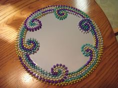Mardi Gras Mirror Materials : Authentic New Orleans Mardi Gras beads, large round mirror, glue Started : July 5, 2010 Completed : Jul... Mardi Gras Beads, Mardi Gras Party, Mardi Grad, Mardi Gras Decorations, Mardi Gras Centerpieces, New Orleans Mardi Gras, Beads Pictures, Beaded Crafts, Jewelry Crafts