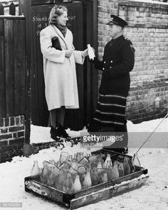 A milkman makes a delivery to Streatham Grammar school in London, 1939.