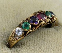 Another view: A Georgia era, early 19th century, 'Dearest' ring, the first letter of each stone represents a letter in the word 'dearest'  Diamond -D Emerald - E Amethyst - A Ruby - R Emerald - E Sapphire - S Topaz - T