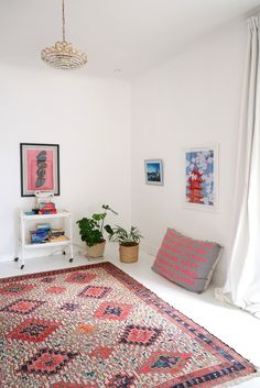 Have a spare room asking for a purpose? Why not keep it simple and add a meditation or gallery room to your home? Lian and Fabien did just that with a large rug, some floor pillows, plants, and art on the walls. A place to read, relax, hang out, do yoga, or dance!