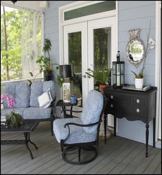 screened porch furniture - I like the vintage looking table in the back