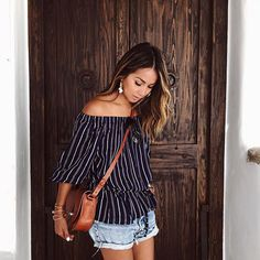 Exploring Mykonos in this off the shoulder @storets top & favorite Levi's