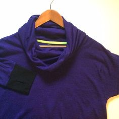 RBX Fitness top. This is a heather purple color. Thumb holes and from hoodie pocket. Some pilling. Poly and spandex. RBX Tops Sweatshirts & Hoodies