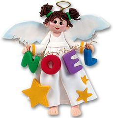 """Noel Angel Ornament. Free Ground Shipping. An Angel Christmas ornament holding """"Noel"""" will remind everyone of the old time favorite Christmas song, """"First Noel The Angel Did Say"""". Hanging from the tree, your Angel ornament will always be smiling, wearing her halo, and decorated with stars on the front of her dress. She is a sweet and colorful Angel Ornament. Handmade from Polymer Clay. Approximately 4"""" High x 4"""" Wide. $12.99. https://www.happyholidayware.com/product/noel-angel-ornament/"""