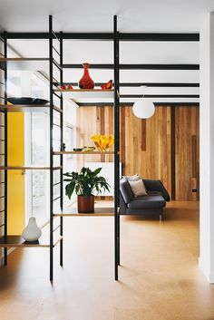 Open shelving lends an organizing grid without obstructing views.
