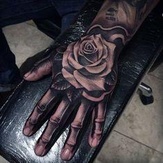 75 skeleton hand tattoo designs for men - manly ink ideas Flower Tattoo Hand, Rose Flower Tattoos, Rose Tattoos For Men, Hand Tattoos For Women, Tattoo Flowers, Mens Hand Tattoos, Tattoo Sleeve Designs, Flower Tattoo Designs, Tattoo Designs Men