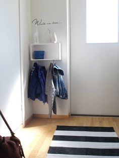 The hall is tiny, without this much space, but I'm thinking a few little triangle shelves arranged in the corner beside the door! Kind of like this but on a smaller scale. Brilliant!