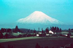 BEFORE: Mount St. Helens from the south, as seen from West Linn, Oregon.   USGS Photograph taken in 1977 by Ken Cameron.