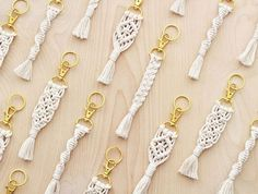 These macrame keychains are handcrafted from soft white cotton cord and attached to a gold swivel snap hook. Also included is a 1 gold key ring. A fun accessory for your keys or snap it on as flair for your bag. Pick one from 4 styles shown - if you want multiple styles, you can purchase the correct amount and message me what styles you would like. Style A - Spiral 5 long and 1/2 wide Style B - Diamond 5 long and 1 wide Style C - Braid 5-1/2 long and 1/2 wide Style D - Fis...