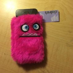 """Claire's cell phone holder Brand new cell phone """"sock"""" holder from Claire's! It is pink and fuzzy with a silly fabric face on the front! Still has tags! Comes from a pet and smoke free home. (Does not include cell phone) Claire's Accessories Phone Cases"""