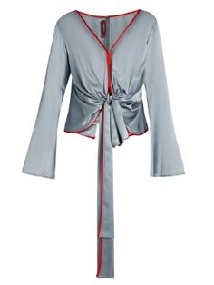 Sies Marjan's dusky-blue silk-charmeuse blouse is the embodiment of modern elegance. It's cut to fall languidly over the body with a knotted front, cape-style back panels and finger-skimming fluted cuffs, while bold red piping defines the edges. Wear it with the matching midi skirt.