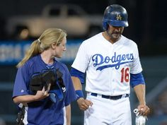 Los Angeles Dodgers center fielder Andre Ethier is assisted off the field by assistant athletic trainer Nancy Patterson Flynn after suffering an injury. / Kirby Lee, USA TODAY Sports