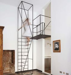 """""""Designer Francesco Librizzi added this contemporary metal rod staircase to an original house in France built in 1900, saying """"the only possible intervention was an almost 2D-frame, able to double the space in height and create new possibilities on other layers."""""""" From weburbanist.com"""