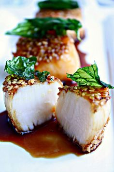 Honey Soy Glazed Sesame #Scallops with Fried Basil Leaves.  These are the best scallops I have ever had. www.wozzkitchencreations.com