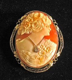Oval white gold framed cameo chatelaine brooch with diamondsearly 20th centuryPerfect bust wearing a diamond necklace with a single diamond in an openwork frame.L: 2 1/4in.